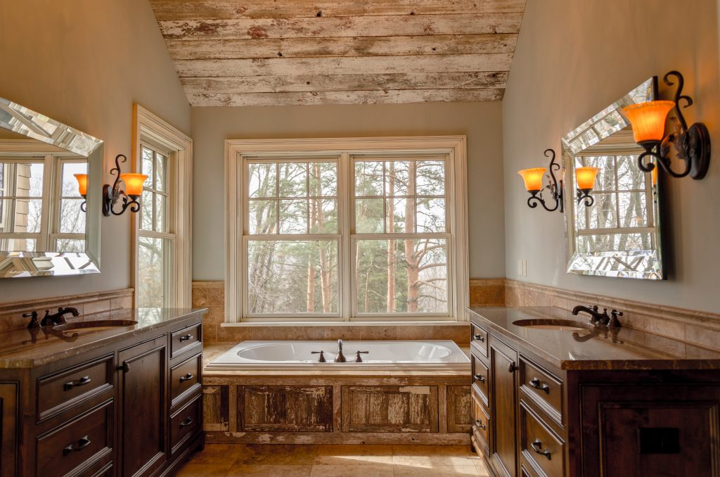 Rustic bathroom with wood cabinets and bath