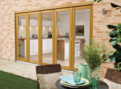 Supreme Solid Oak Bifold Doors - Part Q Compliant Image